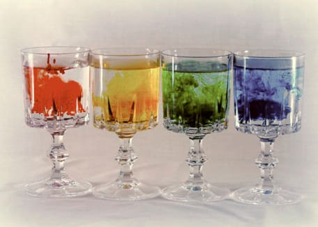 colored water in glasses side by side