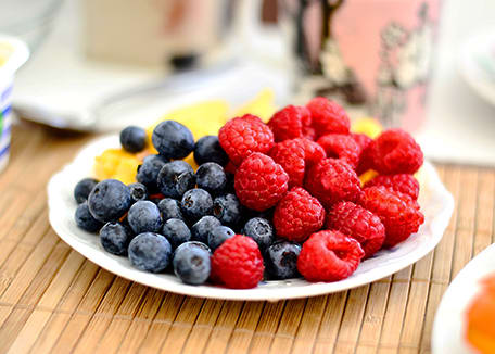 Credit:Plate of multicolored berries on wooden table;Cecilia Par at Unsplash.com