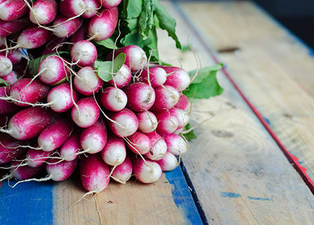 Credit:Radishes on wooden table;Damien Creatz at Unsplash.com