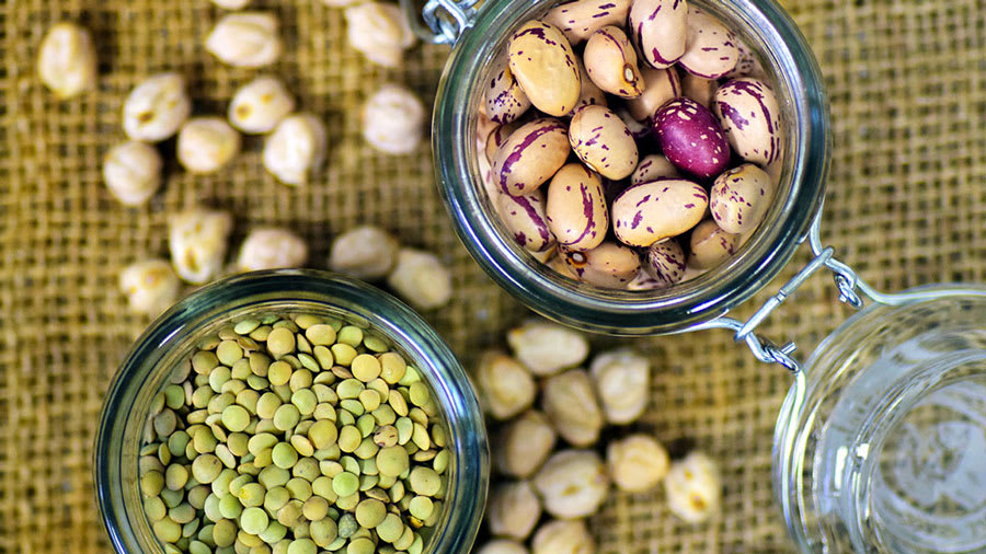 quail beans, legumes, lentils in glass jars