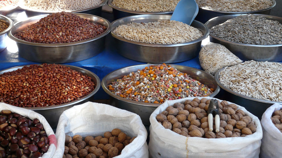 Grains and nuts arranged in bags and metal bowls