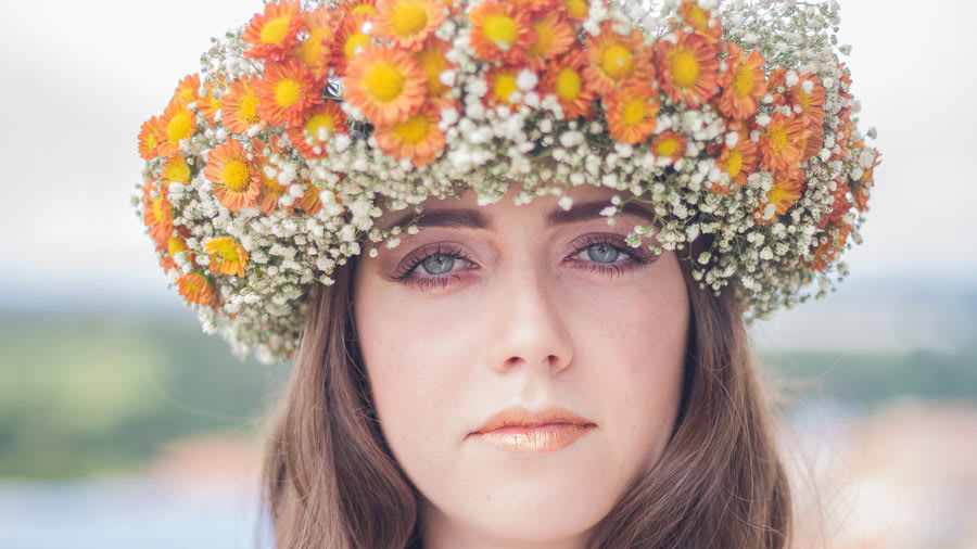 Woman with flower wreath and glittery lips