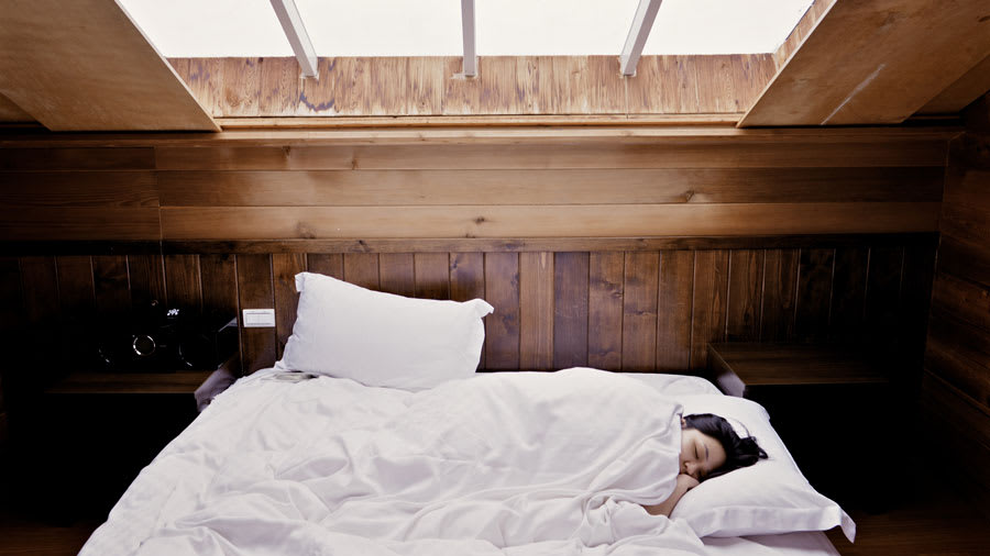 Woman sleeping in relaxing room to improve her skin health