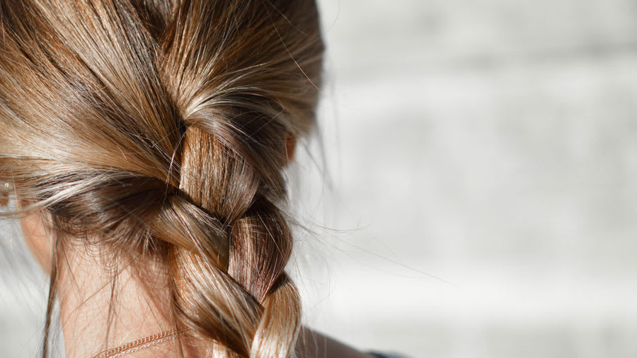 Braided hair of blonde woman
