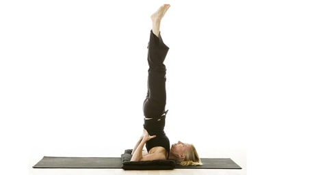 Supported shoulder stand pose in yoga helps lymph flow drain fluid from legs