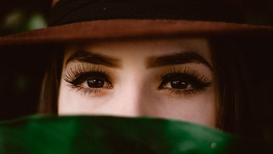 Beautiful woman wearing hat with long eyelashes