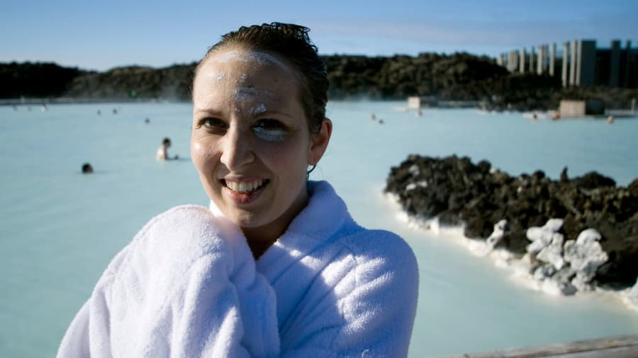 woman with dead sea mud mask remains on face