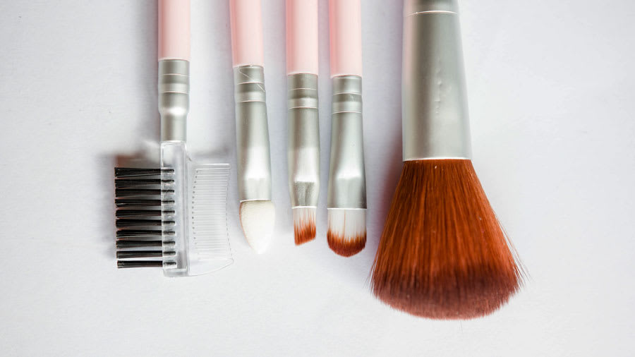 tapered and silicone foundation application applicator brushes against white background
