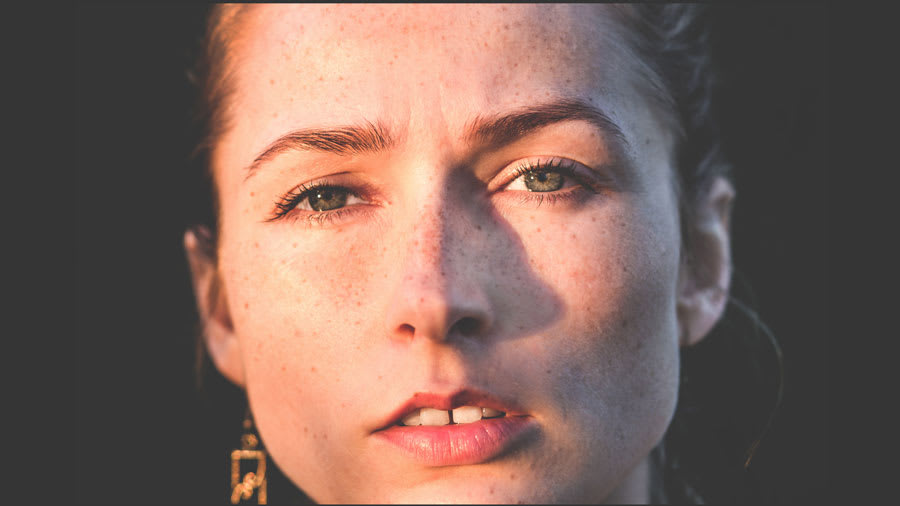 Woman's face with freckles