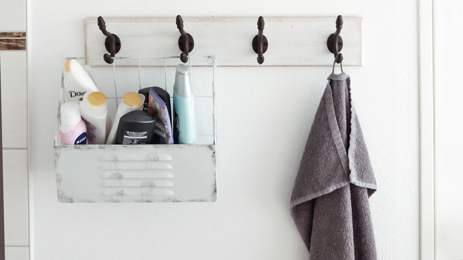 Hair products with formaldehyde releasing ingredients in container and hanging towel on hooks