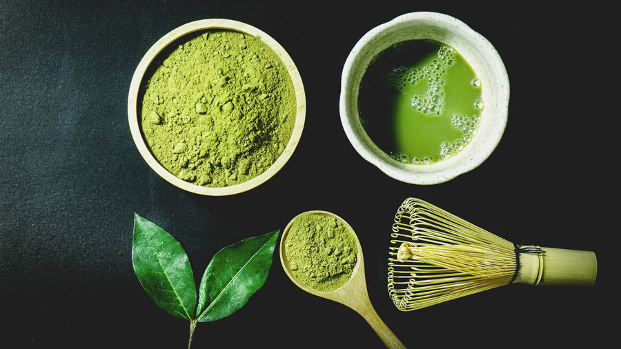 Matcha green tea powder, tea leaf, and tea