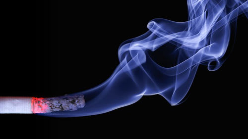Cigarette smoke from burning cigarette