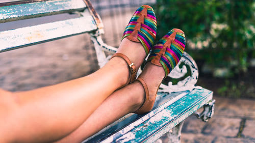 smooth legs on bench with colorful shoes