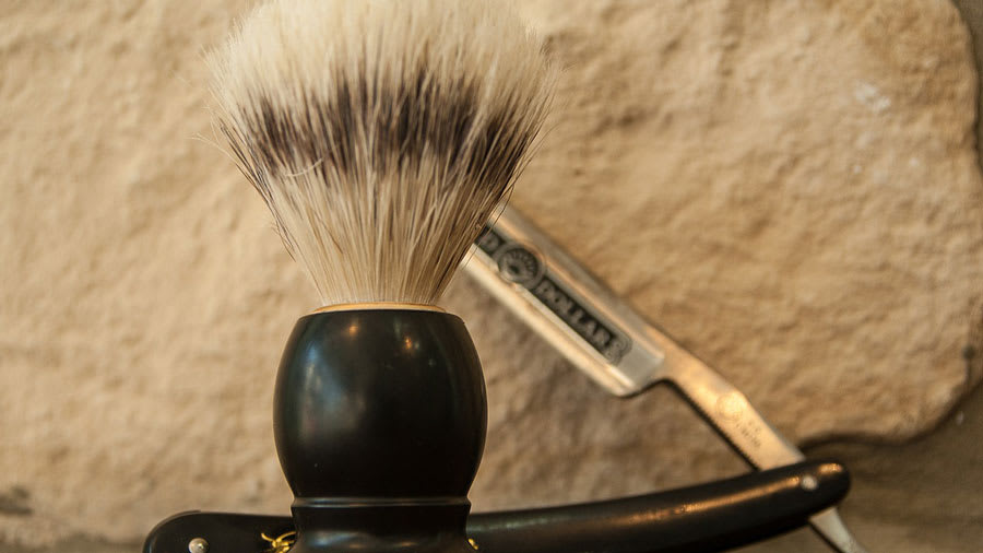 Shaving razor and brush on a table
