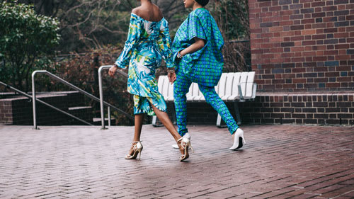 women wearing bright blue clothing walking in heels