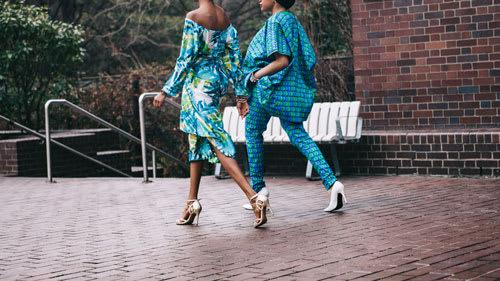 women wearing bright blue clothing walking in heels