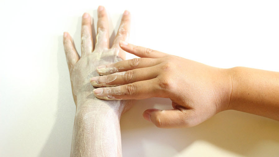 Exfoliating body scrub on the arm