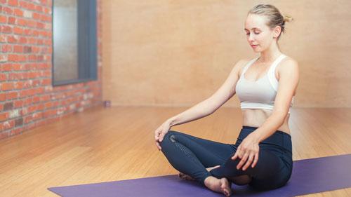 Woman meditation in gym room