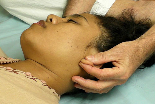 Woman getting ear massage