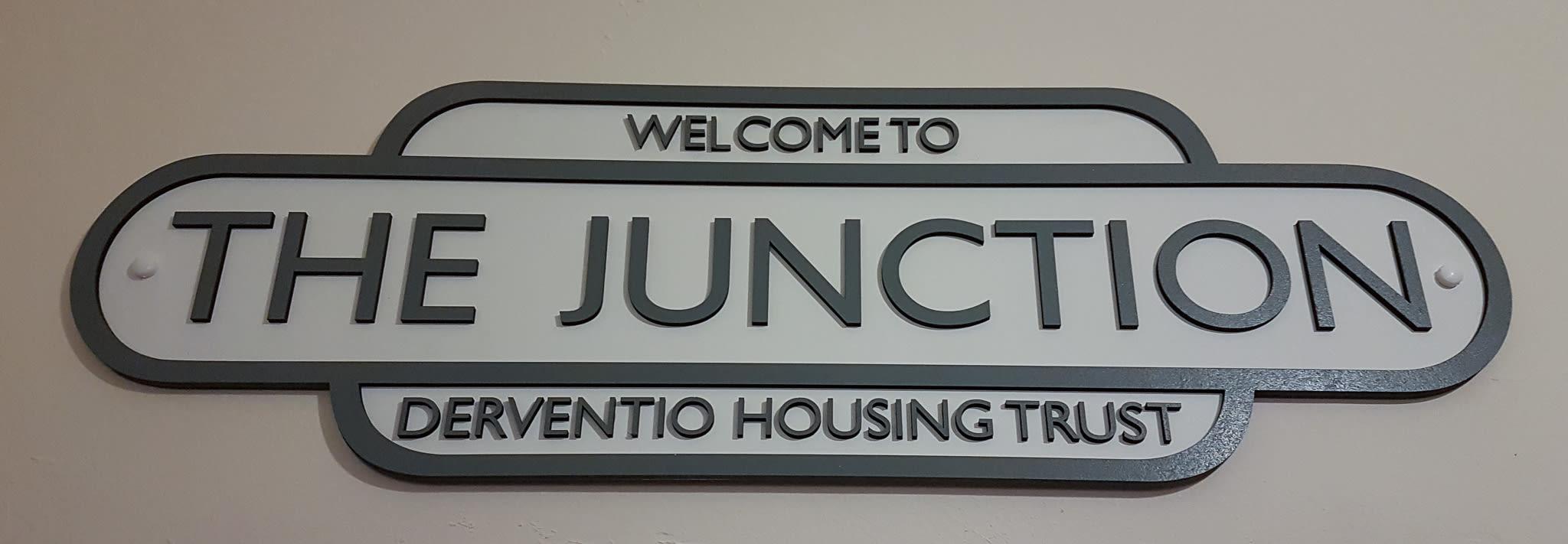 The Junction door sign