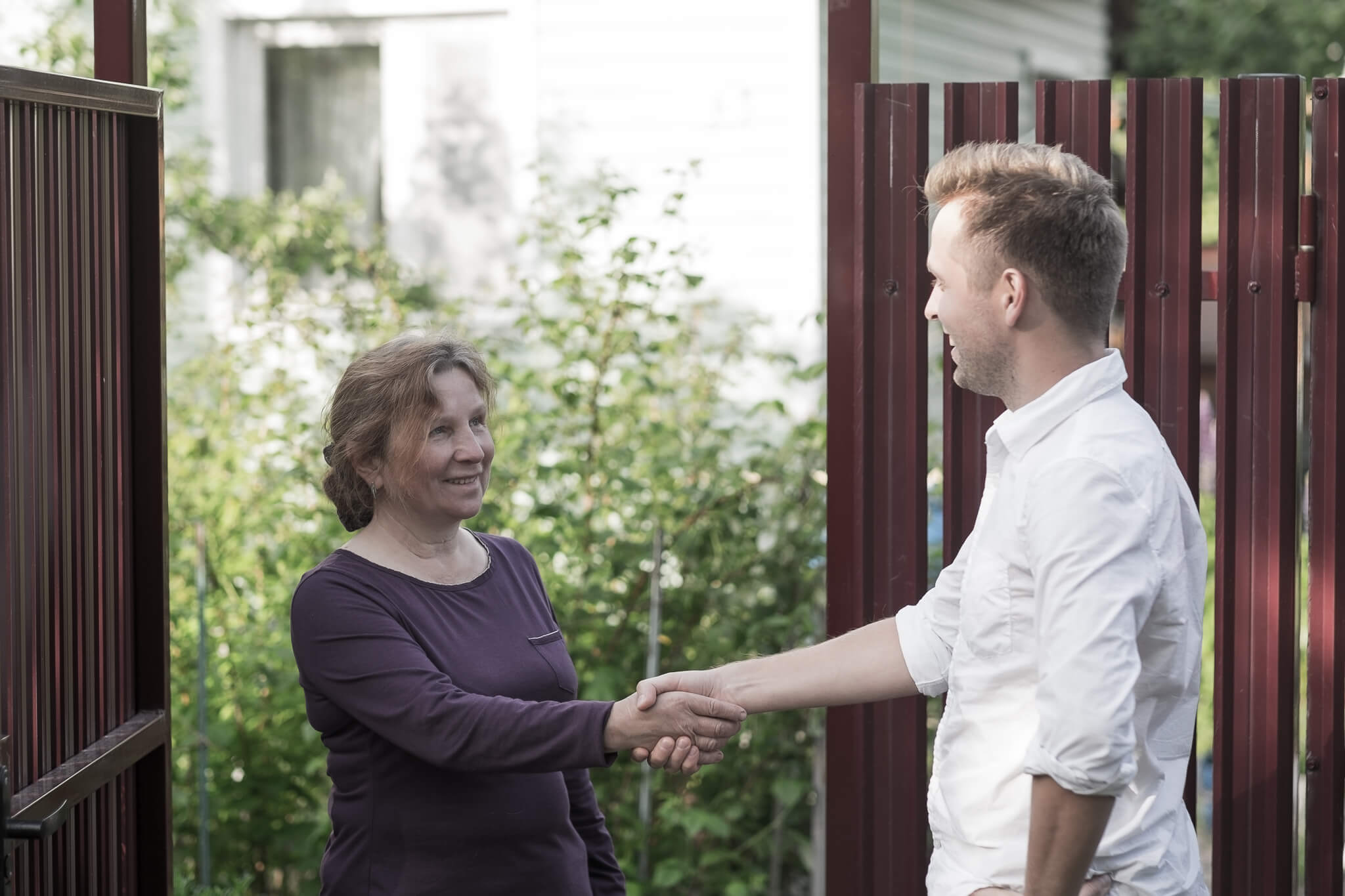 Two people greeting each other outside Derventio supported housing