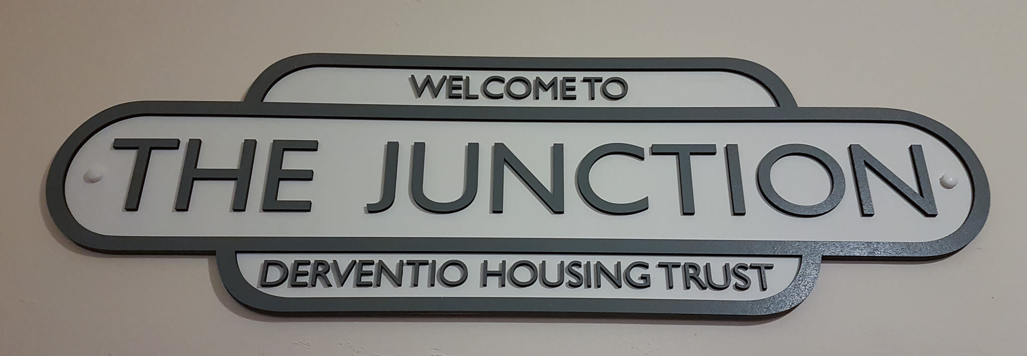 The Junction door sign