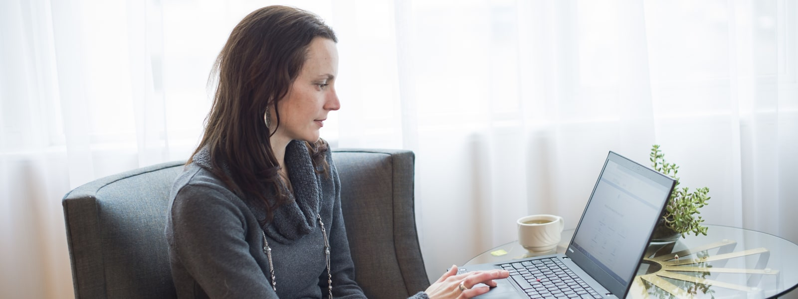 Woman looking at MyChart on a computer