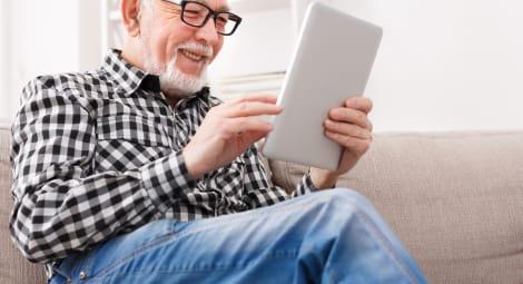 Senior man on digital tablet