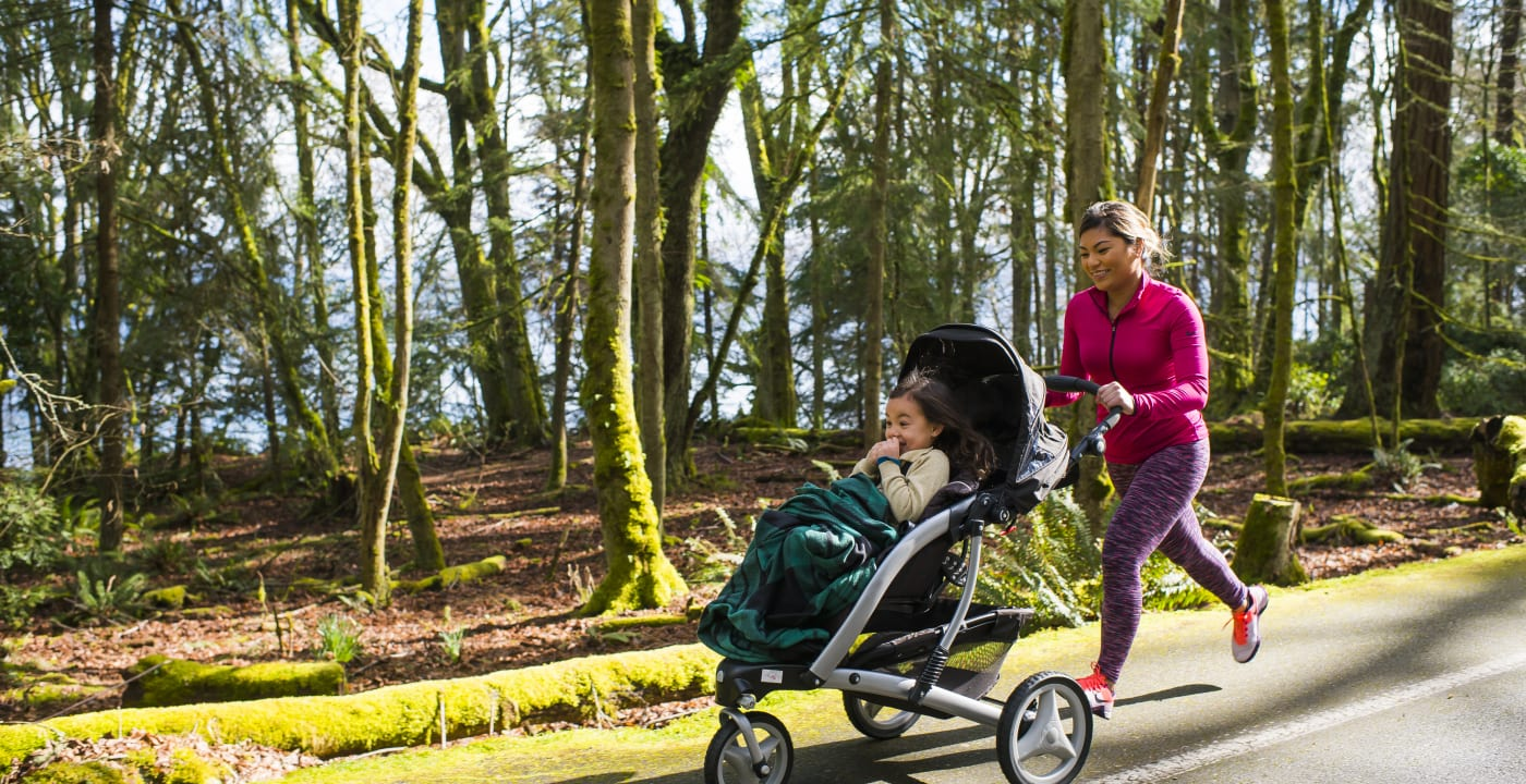 Mother jogging with a child in the stroller