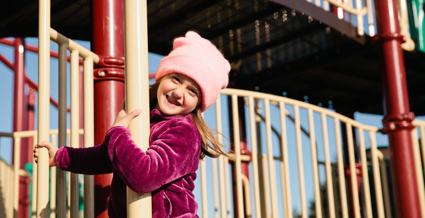 Little girl on playground smiling