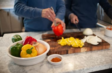 Two men preparing a healthy snack