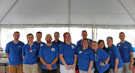 Employees under tent at event