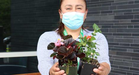 MultiCare volunteer holding flowers