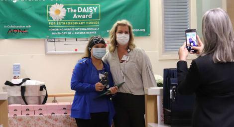 DAISY Award winner Melanie Ives, RN, and nurse manager Sarah Post, RN, pose for photos