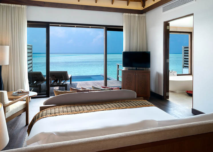 Deluxe overwater bungalow with pool bedroom