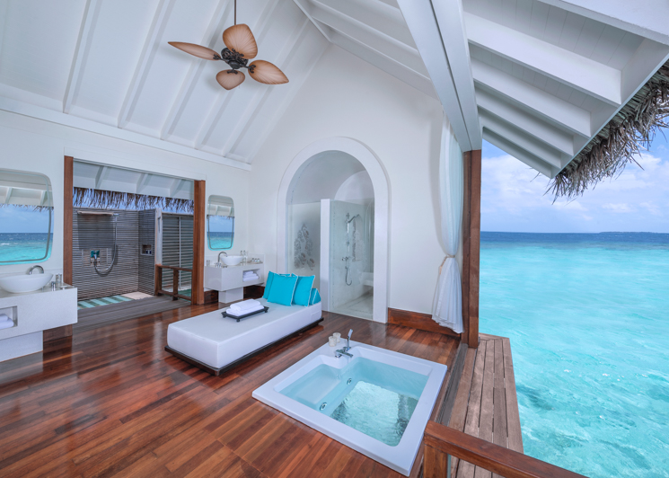 Two bedroom sunset over water pool residence bathroom