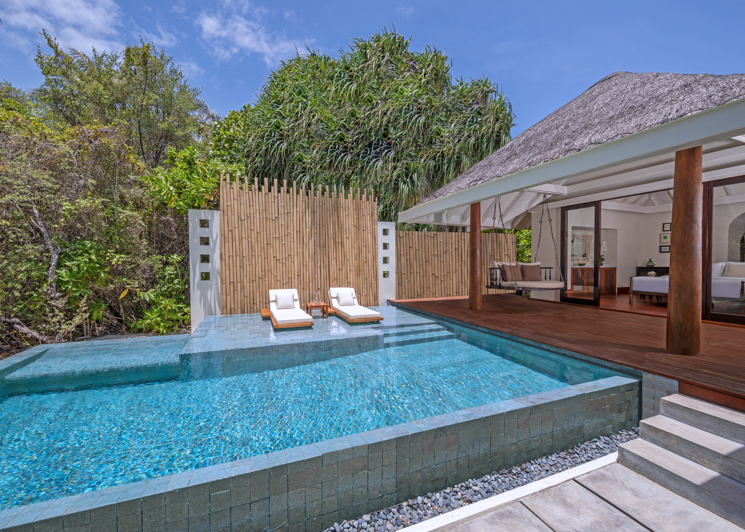 One bedroom beach pool villa deck and swimming pool