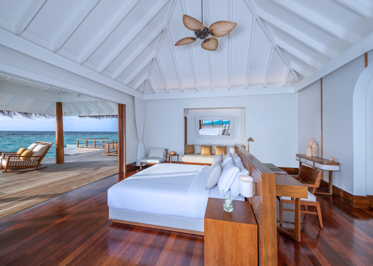 Two bedroom sunset over water pool residence master bedroom interior