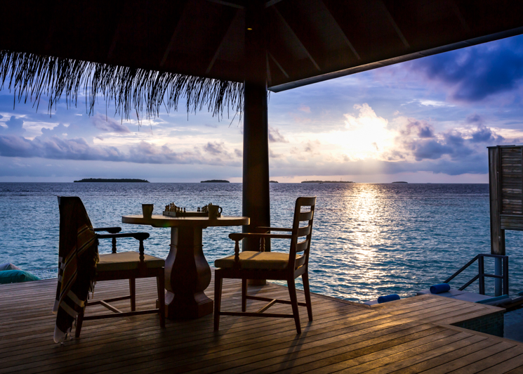 Sunset Over Water Pool Villa Deck