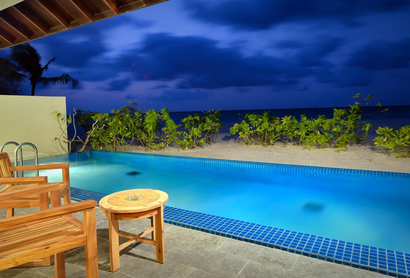 Sunset-pool-villa-exterior-at-dusk