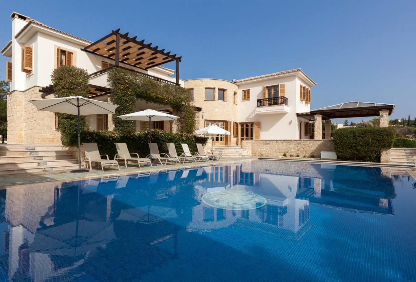 Mythos Collection 5 Bedroom Villa exterior with pool