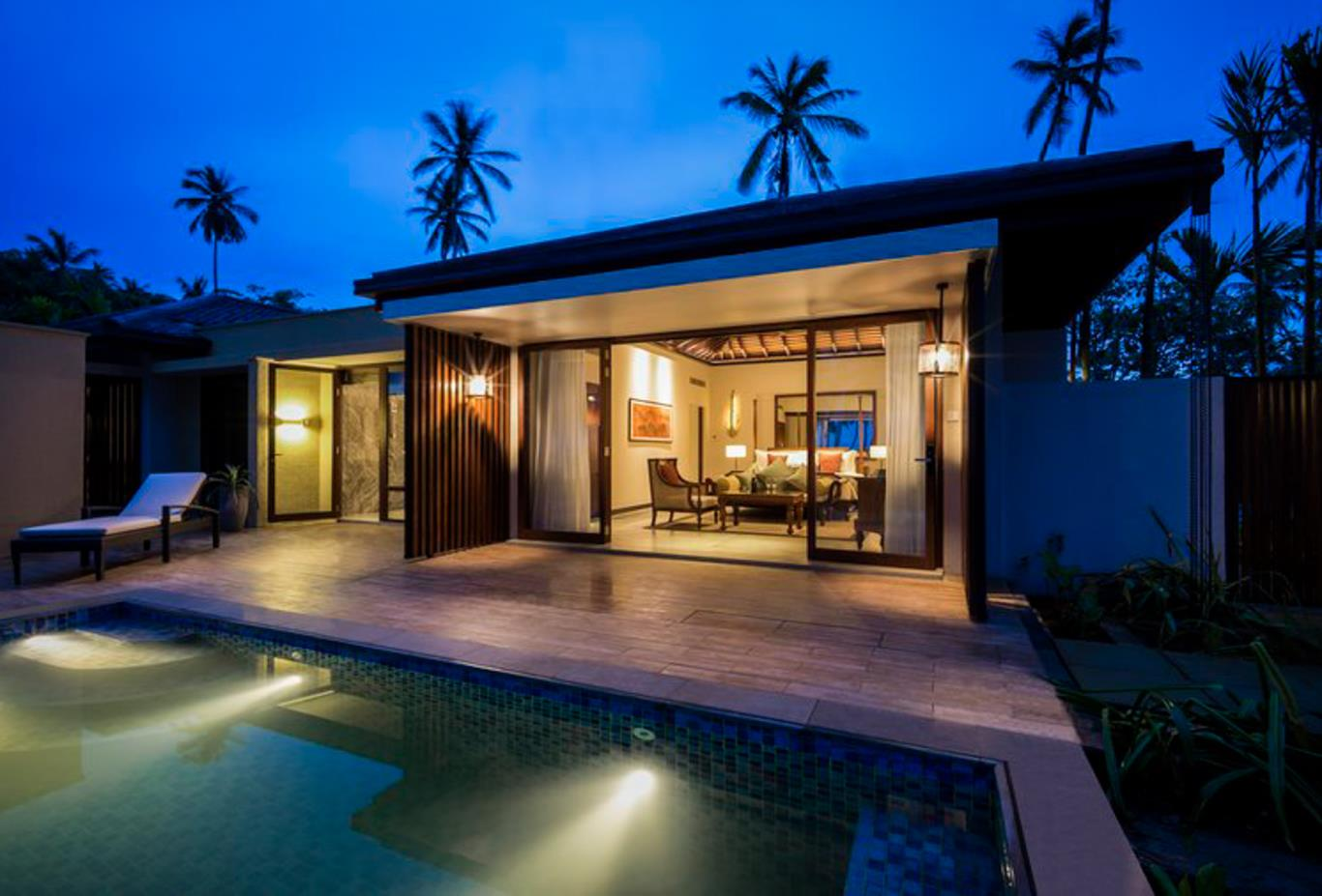 Beach Pool Villa exterior at dusk