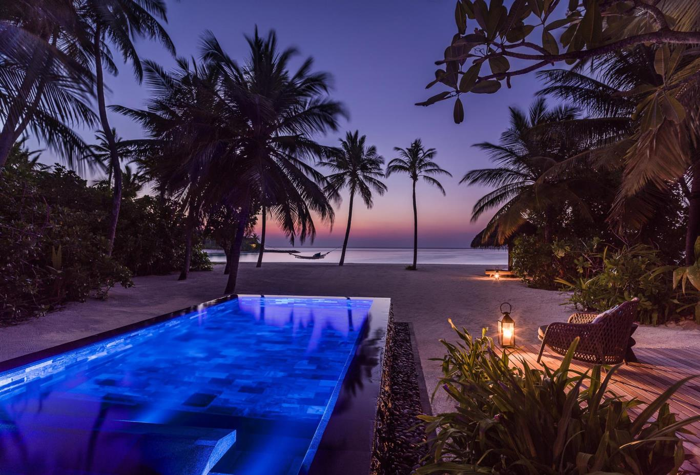 Beach Villa with Pool outdoor deck evening