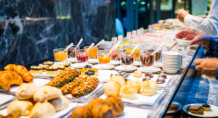 Breakfast buffet including pastries and fruit