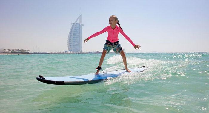 Child surfing in Dubai sea