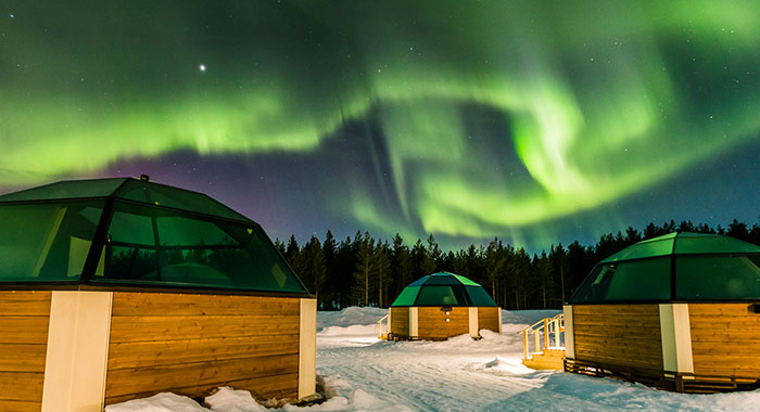 Wooden pods with northern lights