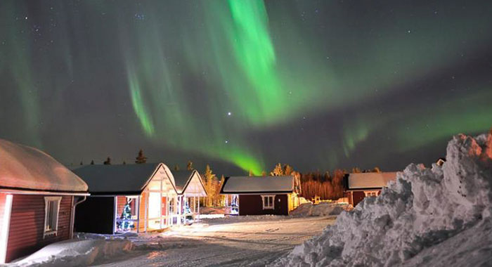 Log cabins and northern lights