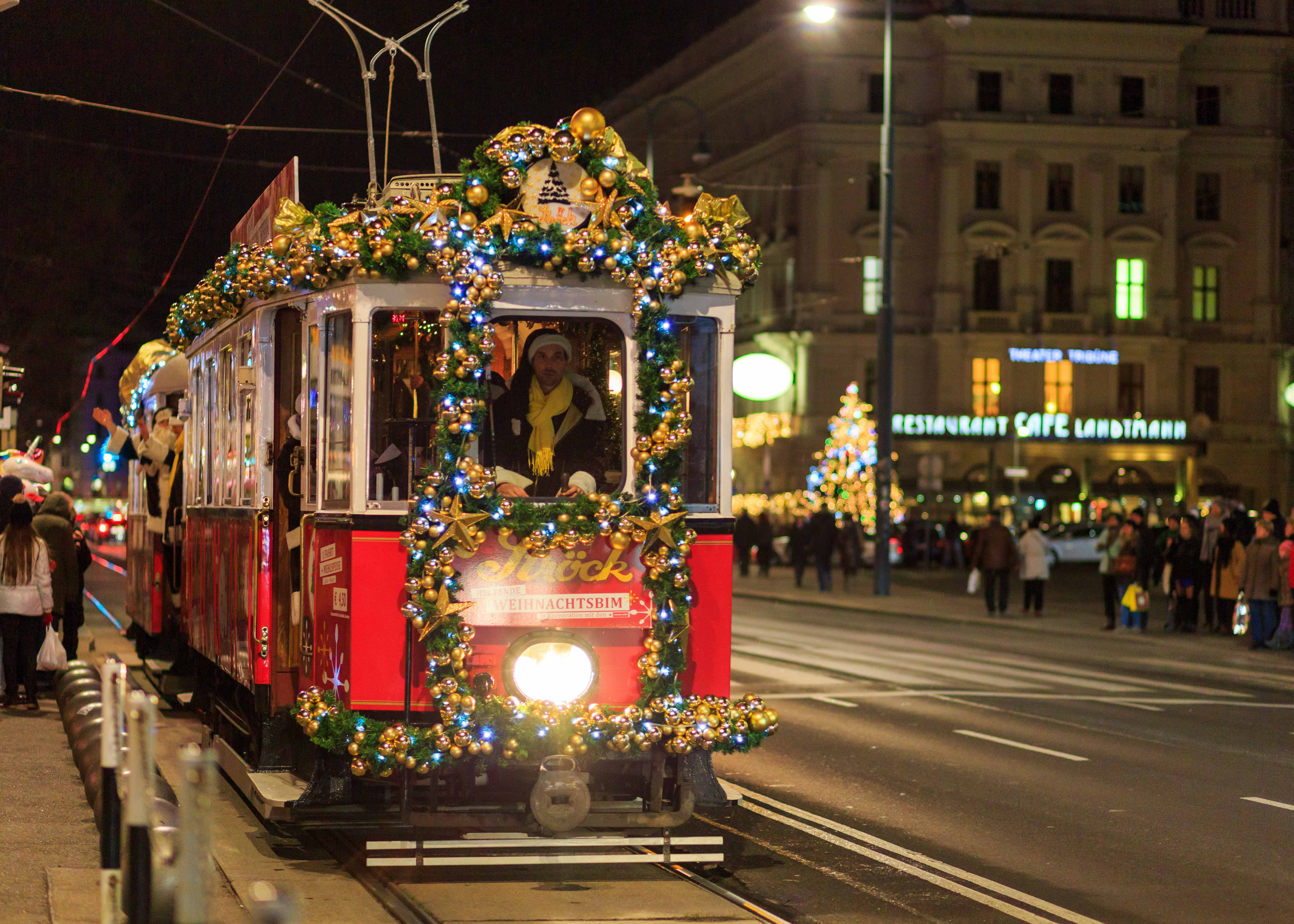 A tram in Vienna at night decprated in Christmas decorations