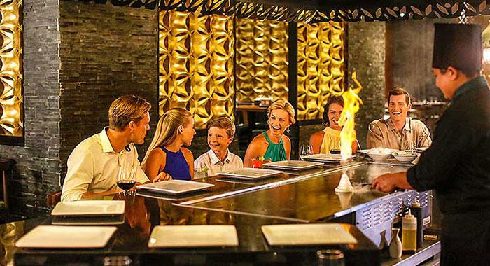 Family sat in restaurant looking at menus