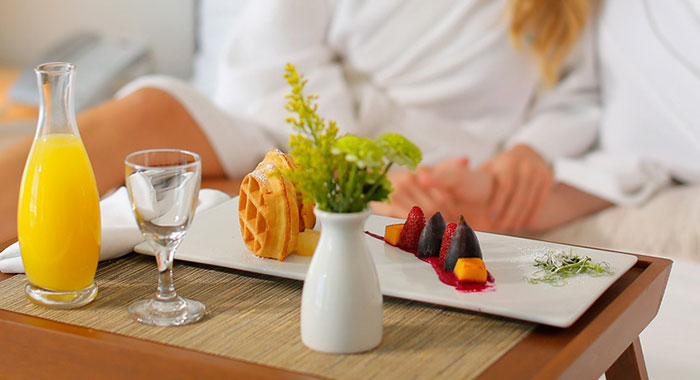Breakfast of waffles and orange juice
